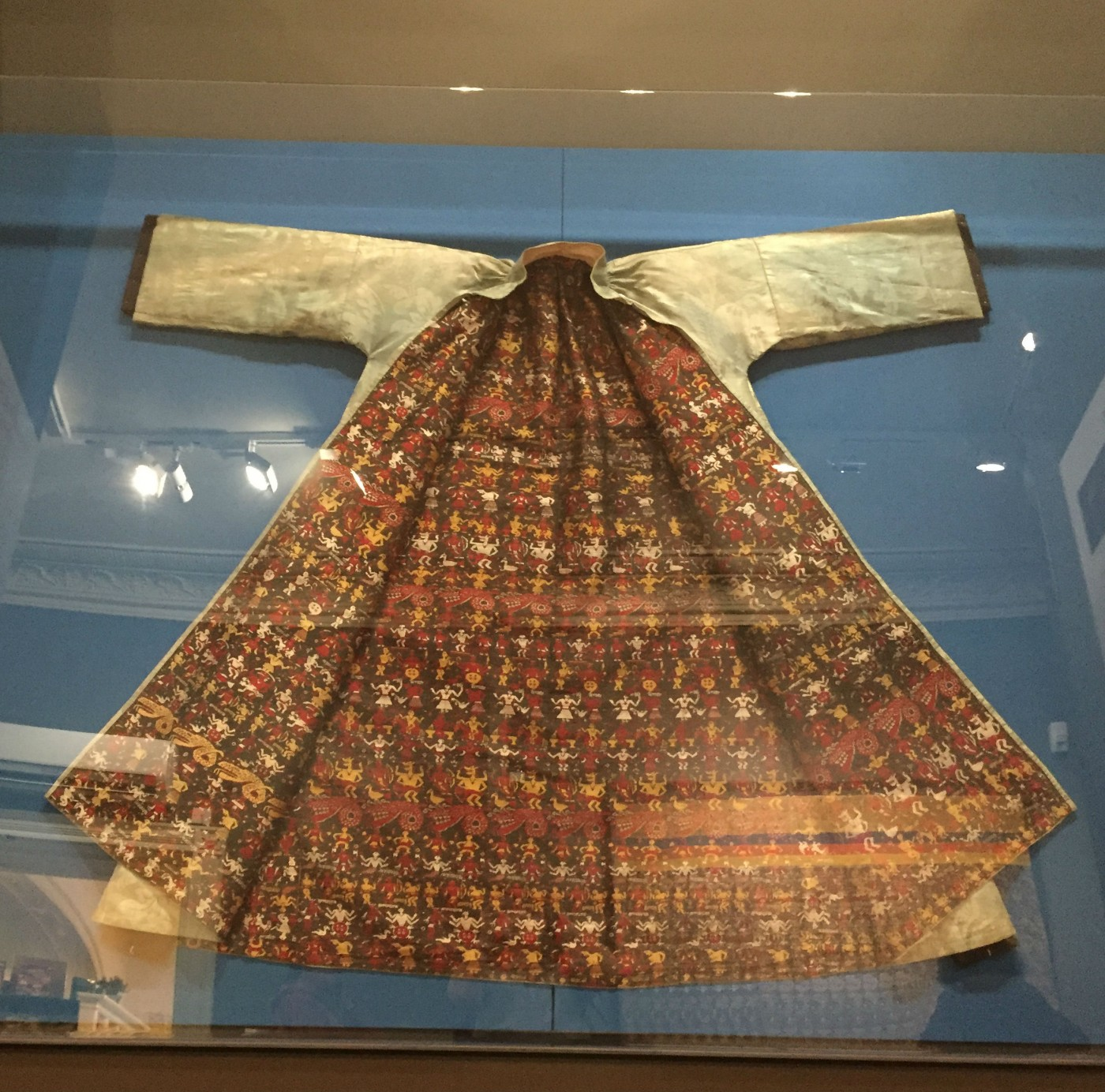 The Chepstow Coat on display at the Chepstow Museum in 'Hidden in the Lining - Krishna in the Garden of Assam', Photo by Olivia Gecseg, 2017