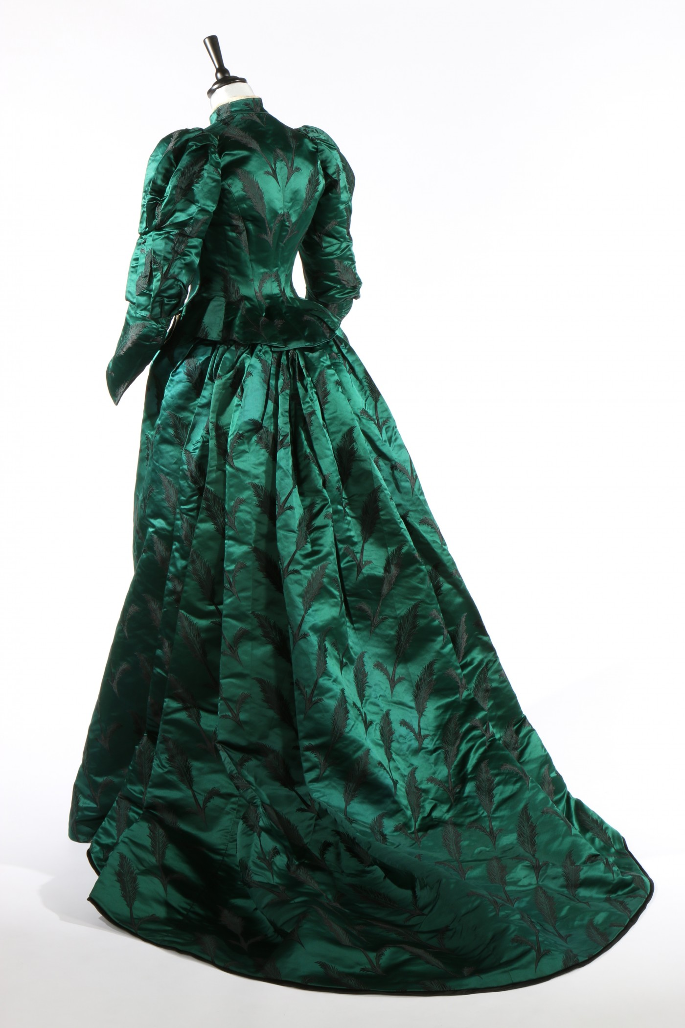 A Charles Frederick Worth, bottle-green brocaded satin gown, circa 1890-93    Image Credit: Kerry Taylor Auctions