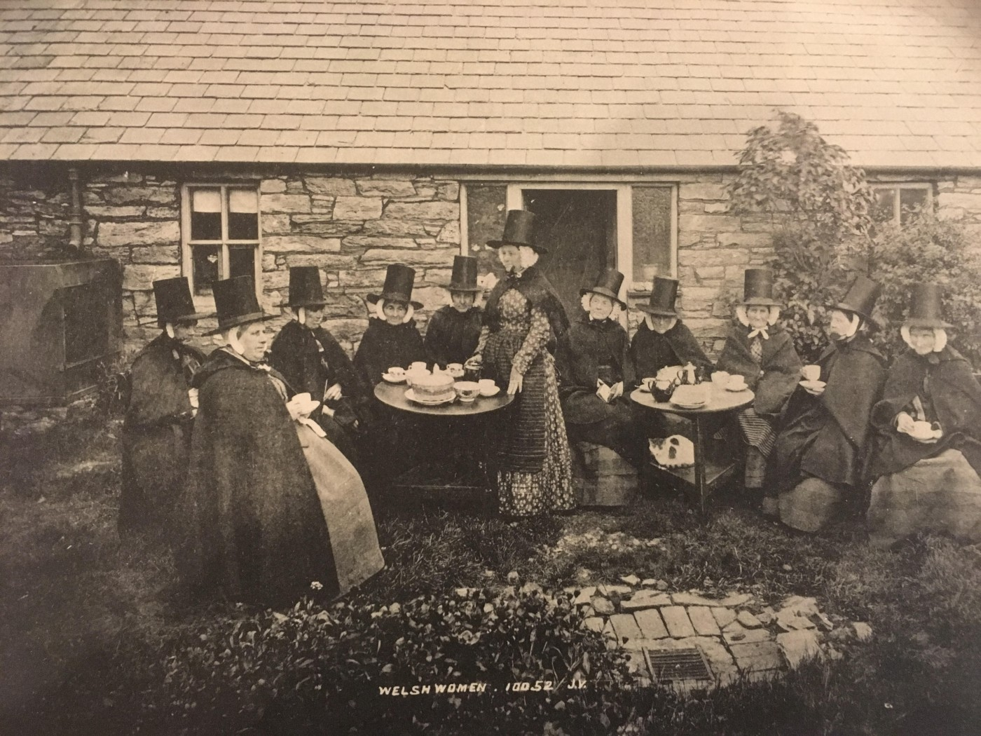 4: Postcard of Welsh women in costume having tea. c.1900. Image courtesy of Y Lanfa Powysland Museum.