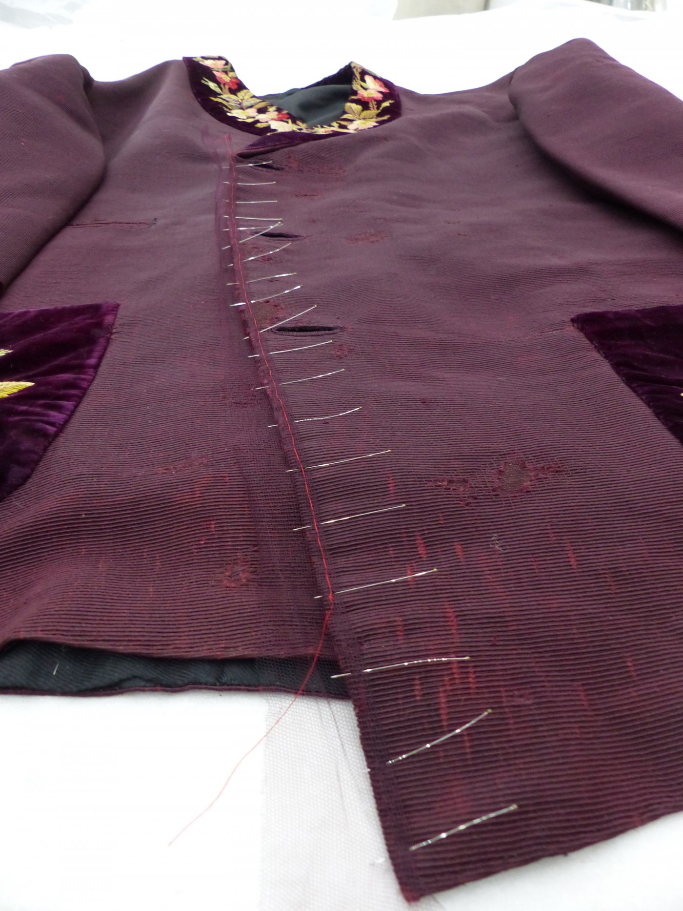Edging the jacket front opening with dyed nylon net © Zenzie Tinker Conservation